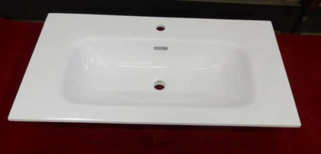 Top in mineralmarmo con vasca integrata bianco lucido