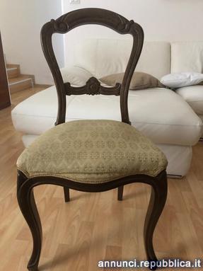 Trittico di sedie usate in legno massello