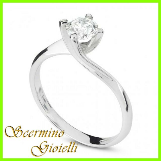 Anello Solitario Oro Bianco: Diamante Naturale 0.60 KT Cert.