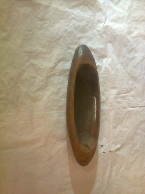Antico utensile in legno,per cucire