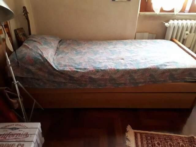 Letto singolo in legno con sotto letto estraibile