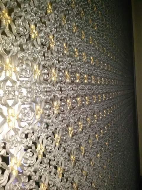 Pannello artistico in ferro battuto con doratura