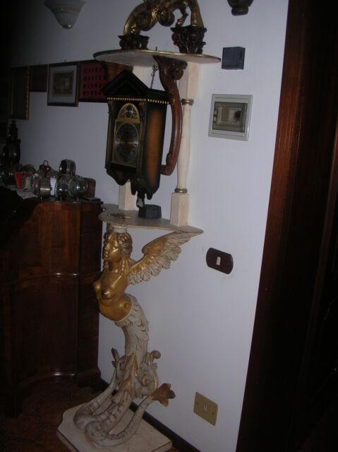 Scultura in legno sirena con orologio a pendolo