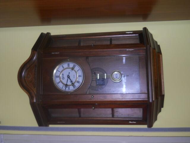 Orologio pendolo a vetrinetta