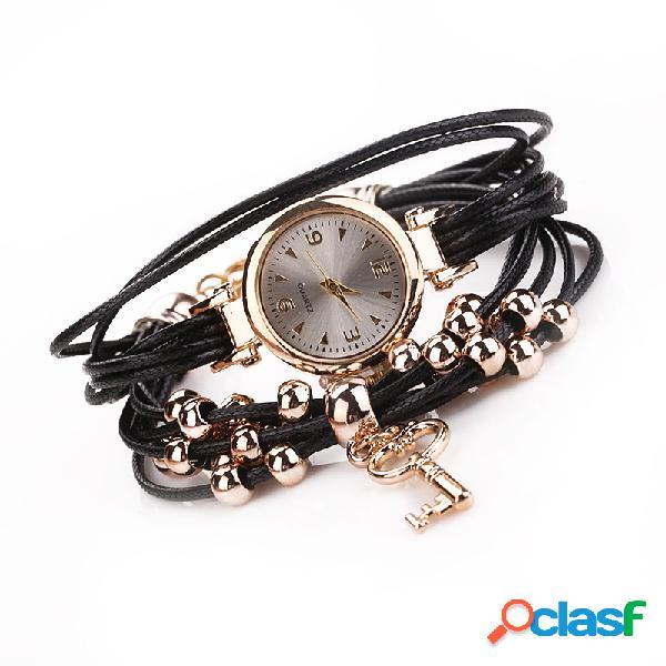 Orologio da polso con cinturino in oro a forma di orologio
