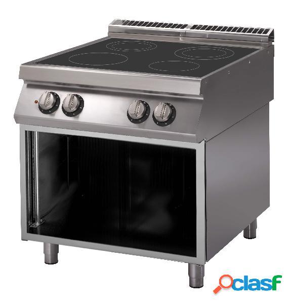 Cucina a induzione su armadio aperto con 4 zone di cottura e