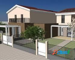 Nuova casa a schiera di testa con giardino