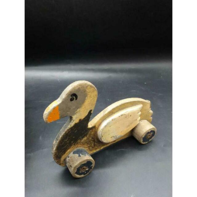 Paperella giocattolo in legno con rotelle